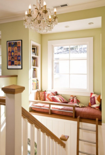 reading loft at end of stairwell with ladder to reach