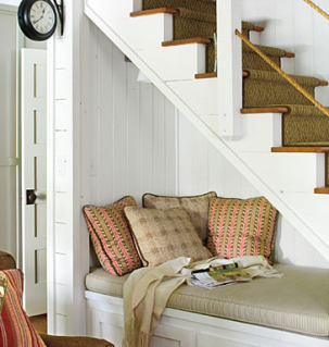 reading nook under staircase colorful pillows and cushion