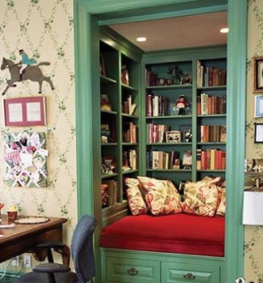 green trim closet with no door and bookshelves