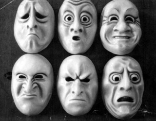 theatrical masks with range of emotion sad surprised mad annoyed scared